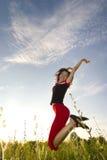 Menina de salto feliz Foto de Stock Royalty Free