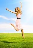 Menina de salto feliz Fotos de Stock Royalty Free
