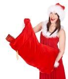 Menina de Santa Claus e do Natal com saco de compras. Imagem de Stock