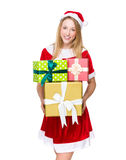 Menina de Santa com lotes do giftbox Fotos de Stock Royalty Free