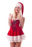 A menina de Santa com polegares levanta o gesto Foto de Stock Royalty Free
