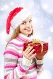 Menina de Santa com uma caixa de Natal Imagem de Stock