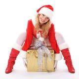 Menina de Santa do Natal com presente Fotografia de Stock Royalty Free