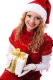 Menina de Santa do Natal com presente Imagens de Stock