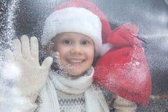 Menina de Santa no Natal fotografia de stock royalty free