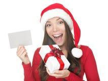 Menina de Santa que mostra o sinal em branco Imagem de Stock