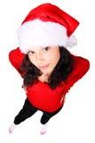 Menina de Santa que olha acima Fotografia de Stock Royalty Free