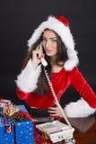 Menina de Santa que responde ao telefone Foto de Stock Royalty Free