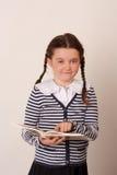 Menina de Schhol com um livro Imagens de Stock