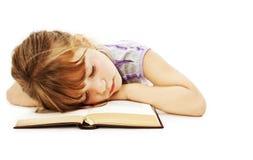 Menina de sono com livro foto de stock