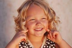 Menina de sorriso. Fotos de Stock