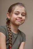Menina de sorriso bonita, cabelo trançado Imagem de Stock Royalty Free
