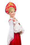 Menina de sorriso bonita do russo no traje popular Imagem de Stock Royalty Free