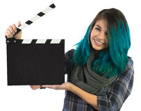 Menina de sorriso bonita que guarda um clapperboard do filme Fotos de Stock Royalty Free