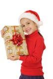 Menina de sorriso com a caixa de presente amarela do Natal Fotos de Stock