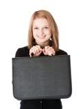 Menina de sorriso com carteira Foto de Stock
