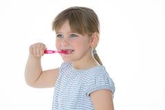 Menina de sorriso com escova de dentes Fotografia de Stock