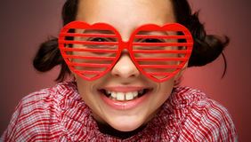 Menina de sorriso com máscaras do obturador Imagem de Stock Royalty Free