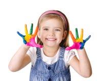 Menina de sorriso com mãos na pintura isolada no branco Foto de Stock Royalty Free