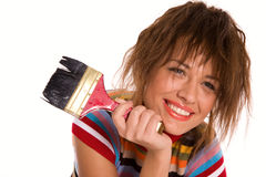 Menina de sorriso com o pincel isolado no branco Foto de Stock