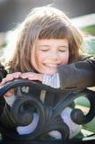 Menina de sorriso com olhos fechados foto de stock royalty free