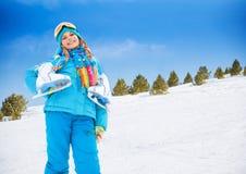 A menina de sorriso com patina no gelo Imagem de Stock Royalty Free