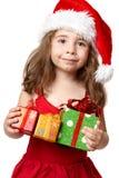 Menina de sorriso com presentes de Natal foto de stock royalty free