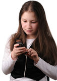 Menina de sorriso com telefone móvel Fotografia de Stock