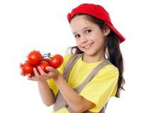 Menina de sorriso com tomates Fotos de Stock Royalty Free
