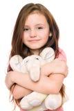 Menina de sorriso com um elefante da peluche Fotos de Stock