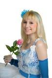Menina de sorriso com uma rosa Fotografia de Stock