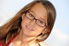 Menina de sorriso com vidros Imagem de Stock Royalty Free