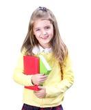 Menina de sorriso da escola com os livros isolados no fundo branco imagem de stock