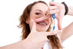 Menina de sorriso das cintas Imagens de Stock Royalty Free