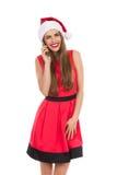 Menina de sorriso de Santa no telefone Imagens de Stock