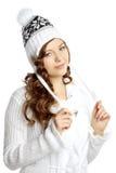 Menina de sorriso do inverno em um fundo branco Fotos de Stock Royalty Free