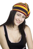 Menina de sorriso em boina listrada no backgroun branco Imagens de Stock Royalty Free