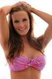 Menina de sorriso em um biquini Imagens de Stock Royalty Free