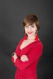 Menina de sorriso em um vestido vermelho Fotos de Stock