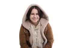 Menina de sorriso em uma capa Fotografia de Stock Royalty Free