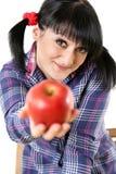 Apple na mão da menina Fotografia de Stock