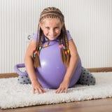 Menina de sorriso na bola Foto de Stock Royalty Free