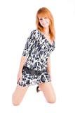 Menina de sorriso na túnica manchada Fotos de Stock