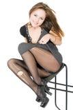 Menina de sorriso nas meias rasgadas Imagem de Stock