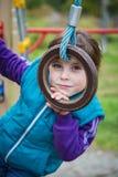 Menina de sorriso no campo de jogos nos esportes Fotografia de Stock Royalty Free
