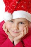 Menina de sorriso pequena bonito de Santa Imagem de Stock