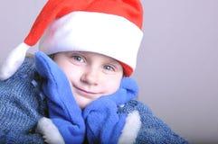 Menina de sorriso pequena bonito de Santa Fotos de Stock Royalty Free