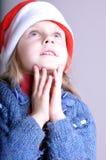 Menina de sorriso pequena bonito de Santa Fotos de Stock
