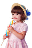 Menina de sorriso pequena com lollipop Foto de Stock