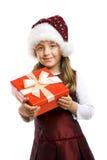 Menina de sorriso pequena com um presente Fotos de Stock Royalty Free